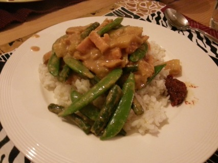 Serve on a small portion of rice and with more spicy sauce if you want!