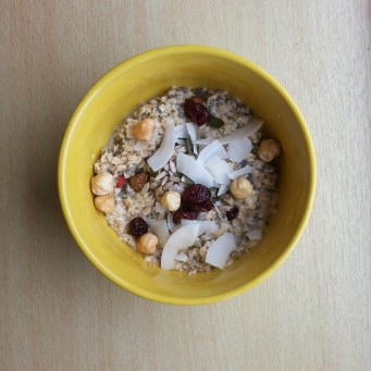 Oatmeal with coconut flakes, hazelnuts, apple-juice sweetened cranberries, pumpkin seeds and sunflower seeds <3